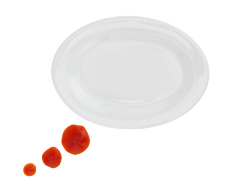 Plate with ketchup stains forming a text bubble isolated on white photo