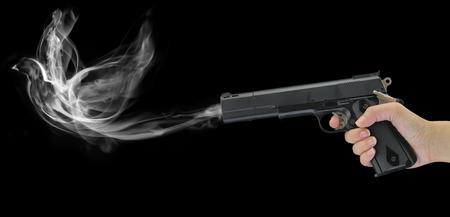 hand gun: Hand holding a smoking gun isolated on black