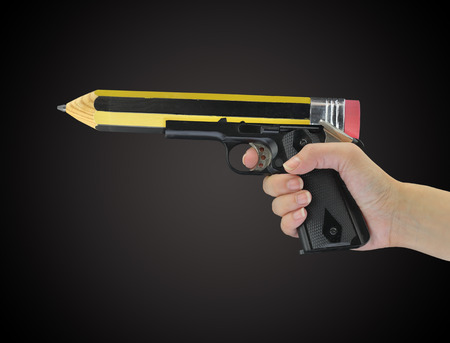 pencil point: Hand holding gun with pencil point isolated on black Stock Photo