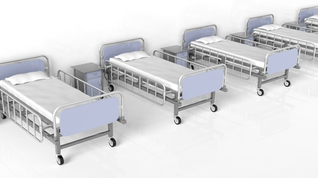 bedside tables: Hospital beds and bedside tables in a row Stock Photo