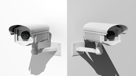big brother spy: Two security surveillance cameras on white wall corner