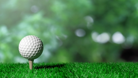 Golf ball on green turf and green background