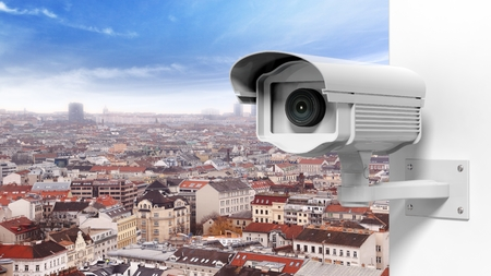 city surveillance: Security surveillance camera over the city