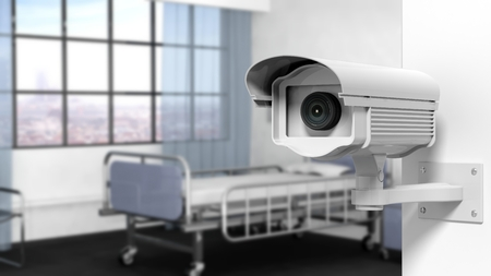 Security surveillance camera on wall in a hospital room Stock Photo