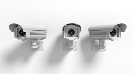 Three security surveillance cameras isolated on white background Foto de archivo