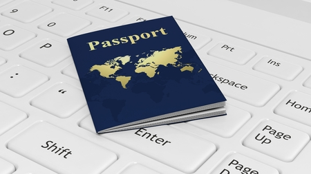 boarders: Passport on white laptop keyboard Stock Photo