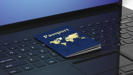 boarders: Passport on black laptop keyboard Stock Photo