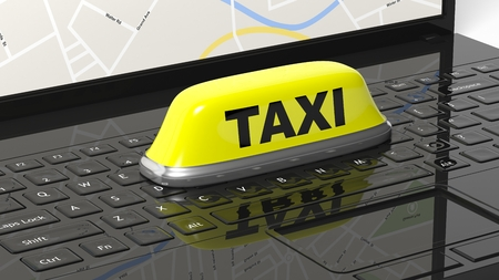 yellow roof: Yellow taxi car roof sign on black laptop keyboard Stock Photo