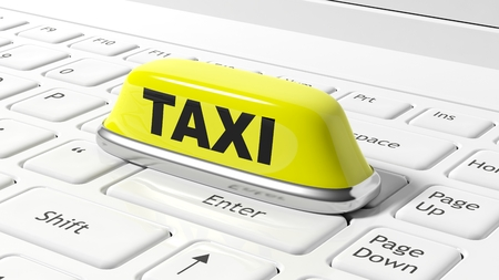 yellow roof: Yellow taxi car roof sign on white laptop keyboard