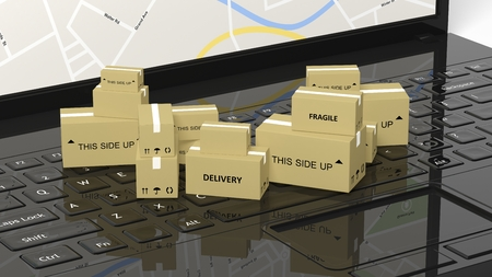 Stack of carton boxes on black laptop keyboard