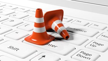 Orange traffic cones on white laptop keyboard Archivio Fotografico