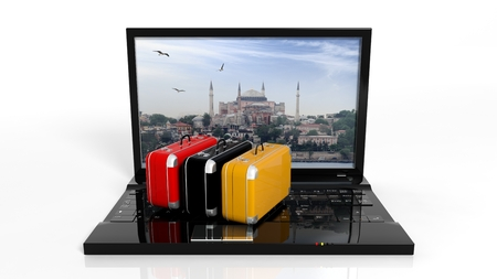hotel booking: Suitcases on black laptop keyboard with Istanbul on screen, isolated