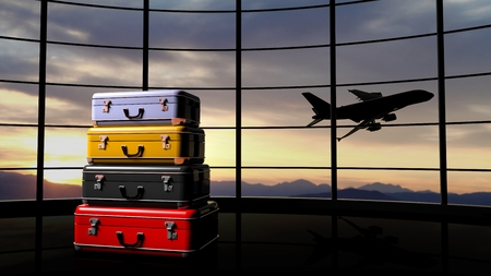 flight: Stack of suitcases beside airpot window with sunset and airplane in flight