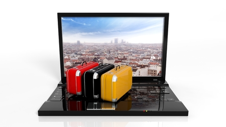 tecnology: Suitcases on black laptop keyboard with city on screen, isolated Stock Photo