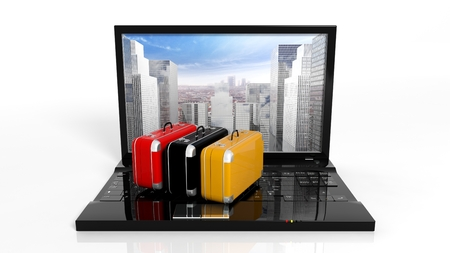 tecnology: Suitcases on black laptop keyboard with skyscrapers on screen, isolated Stock Photo