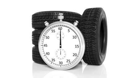 motosport: Silver chronometer with tyres, isolated on white Stock Photo