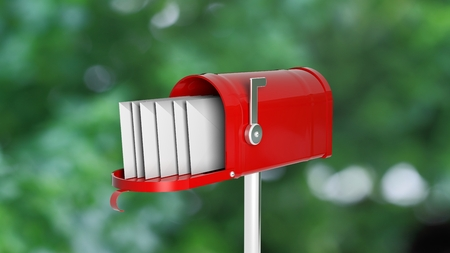 metal mailbox: Red mailbox with letters onabstract green outdoors background