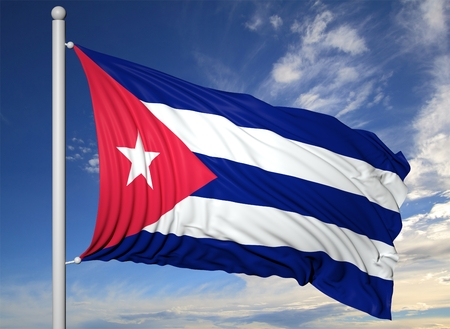 cuban culture: Waving flag of Cuba on flagpole, on blue sky background. Stock Photo