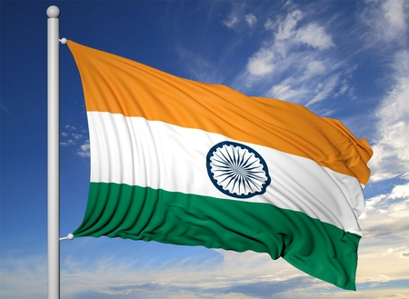 Waving flag of India on flagpole, on blue sky background. Banque d'images