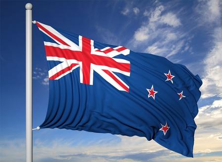 Waving flag of New Zealand on flagpole, on blue sky background.