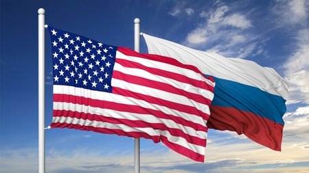 russia flag: Waving flags of USA and Russia on flagpole, on blue sky background.
