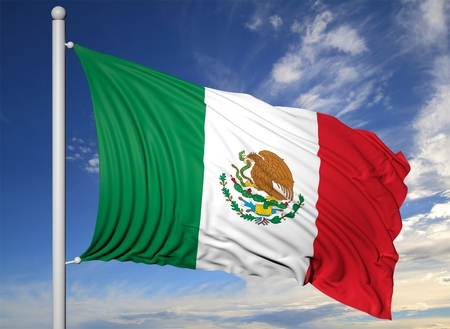 mexico background: Waving flag of Mexico on flagpole, on blue sky background. Stock Photo