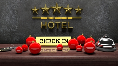 hotel: Christmas balls, hotel bell with check in tag and key on reception desk