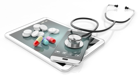 Pills and stethoscope on smartphone and tablet, isolated on white background. Stok Fotoğraf - 46786517
