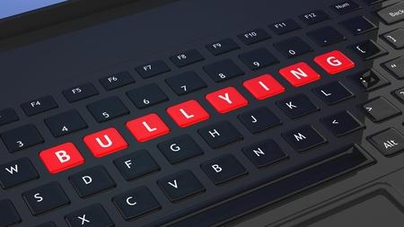 Black keyboard closeup with word Bullying Stock Photo
