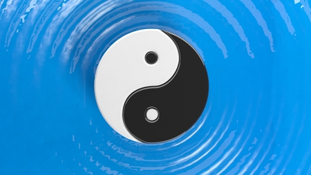 duality: Yin and Yang symbol on blue water with ripples Stock Photo