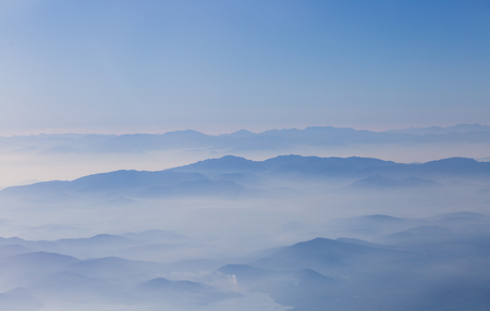 fog white: Aerial photo of wonderful landscape, mountains weltered in the white fog in  early morning