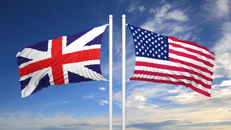 flagpole: British and American flags against of blue sky