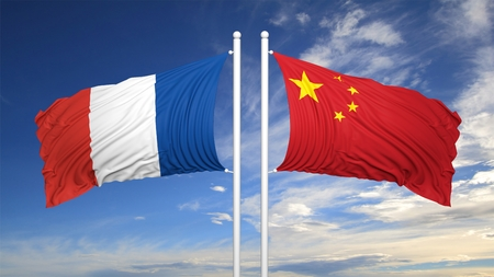coalition: French and Chinese flags waving against of blue sky
