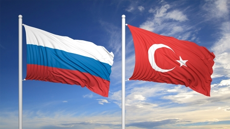 coalition: Turkish and Russian flags waving against of blue sky Stock Photo