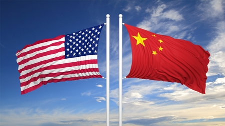 flagpole: American and Chinese flags against of blue sky