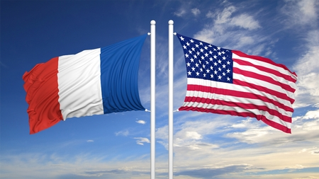 hostility: French and American flags waving against of cloudy sky Stock Photo