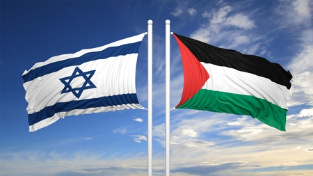 hostility: Israeli and Palestinian flags against of blue sky