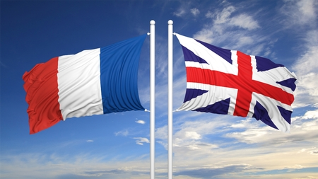 coalition: French and British flags waving  against of sky