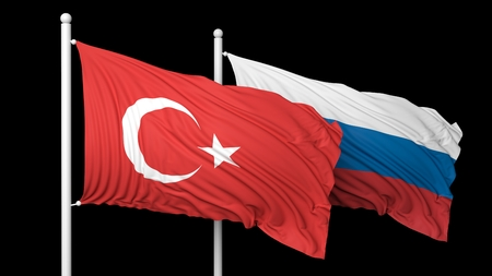 hostility: Turkish and Russian flags waving against of black background