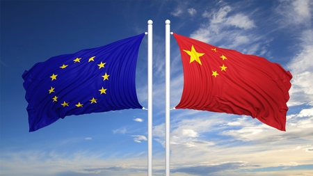eu flag: EU and Chinese flags against of blue sky Stock Photo