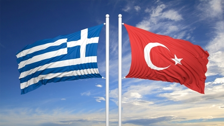 coalition: Greek and Turkish flags against of blue sky