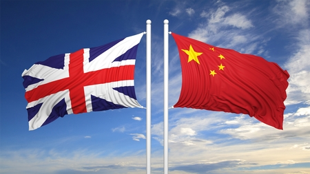hostility: EU and Chinese flags against of blue sky Stock Photo
