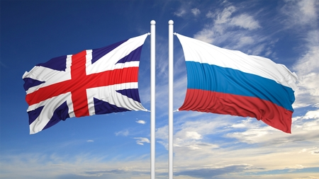 hostility: British and Russian flags against of blue sky