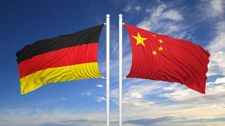 coalition: German and Chinese flags against of blue sky