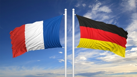hostility: French and German flags waving against of sky