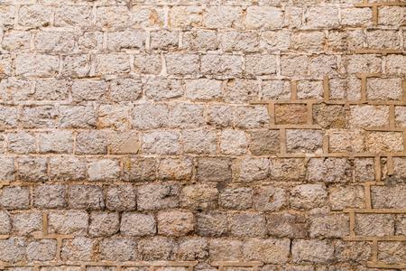 weathered: Old weathered brick wall background Stock Photo