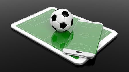 media event: Soccer field with ball on smartphone edge and tablet display, isolated on black.