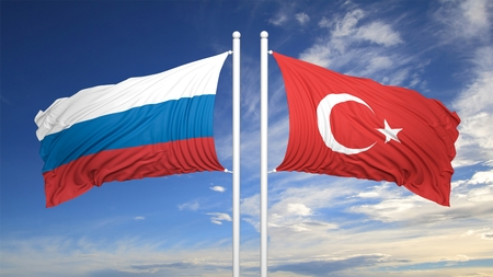 coalition: Turkish and Russian flags against of blue sky