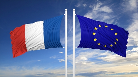 coalition: French and EU flags waving against of blue sky
