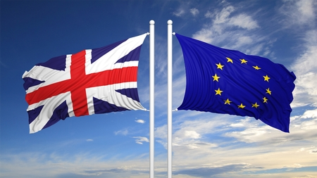 hostility: EU and British flags against of blue sky